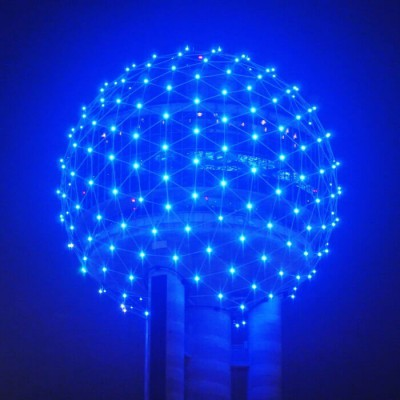 A glowing sphere of blue dots that are glowing dark blue.